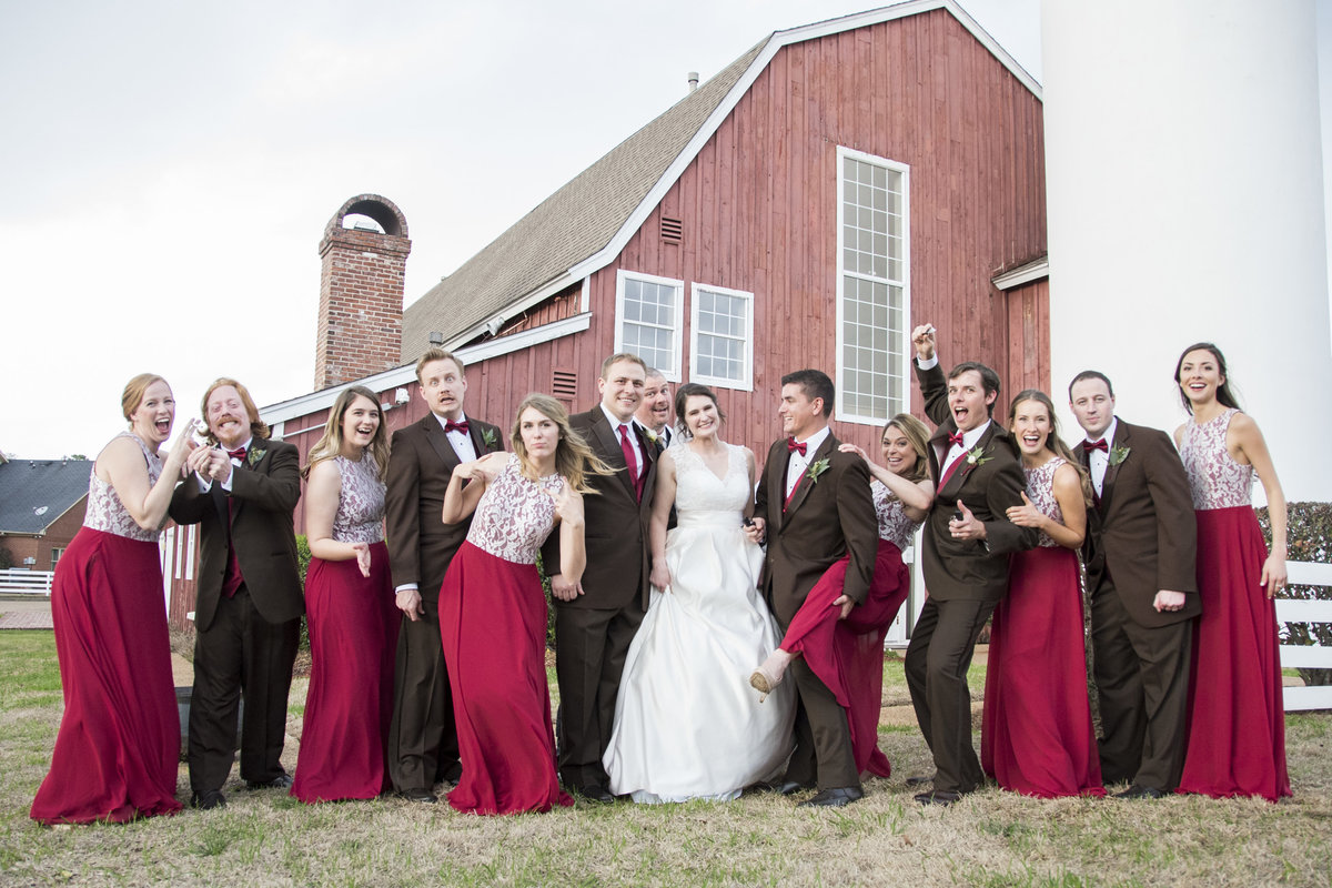 Full bridal party posing funny picture