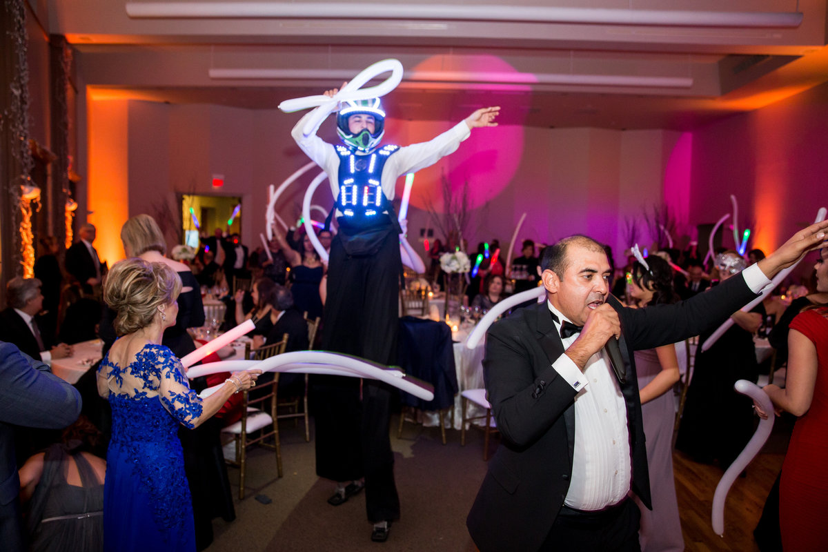 Stilt Walker robot dancing at reception with guests during wedding at The Witte Museum Venue in San Antonio