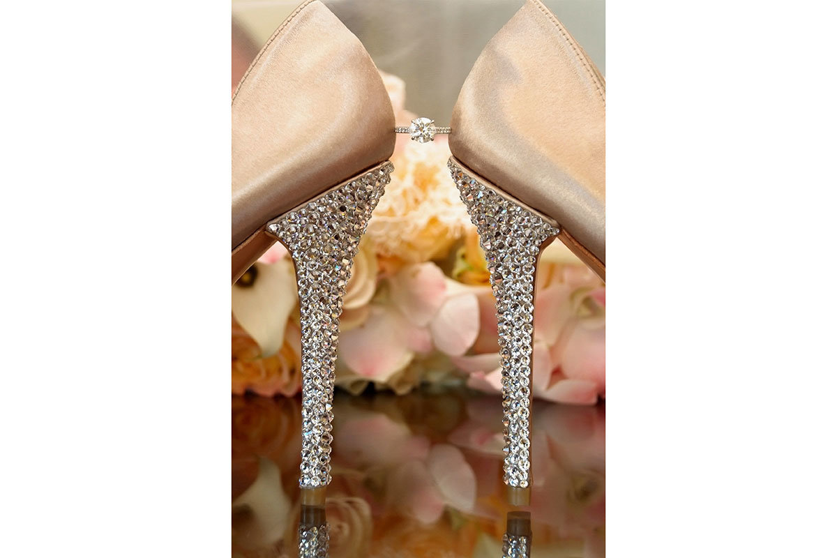 ring between wedding shoes