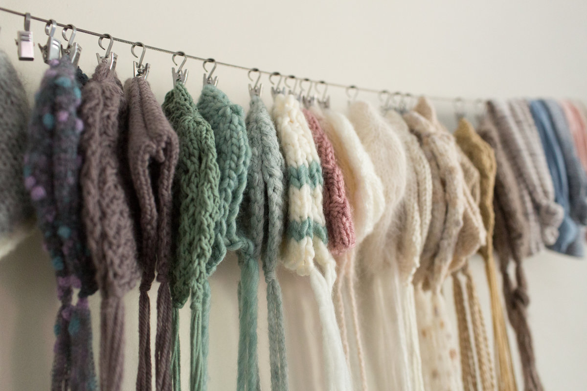 little knit bonnets hanging in photo studio