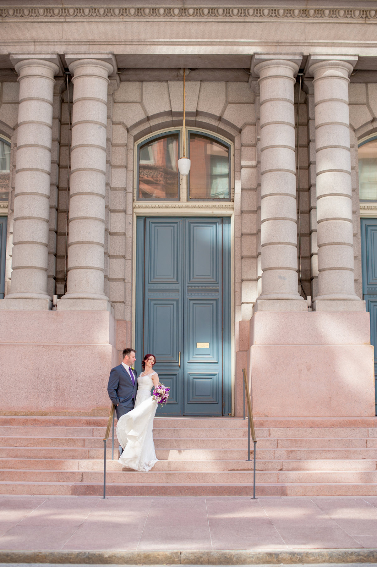 St Louis bride and groom outside on steps
