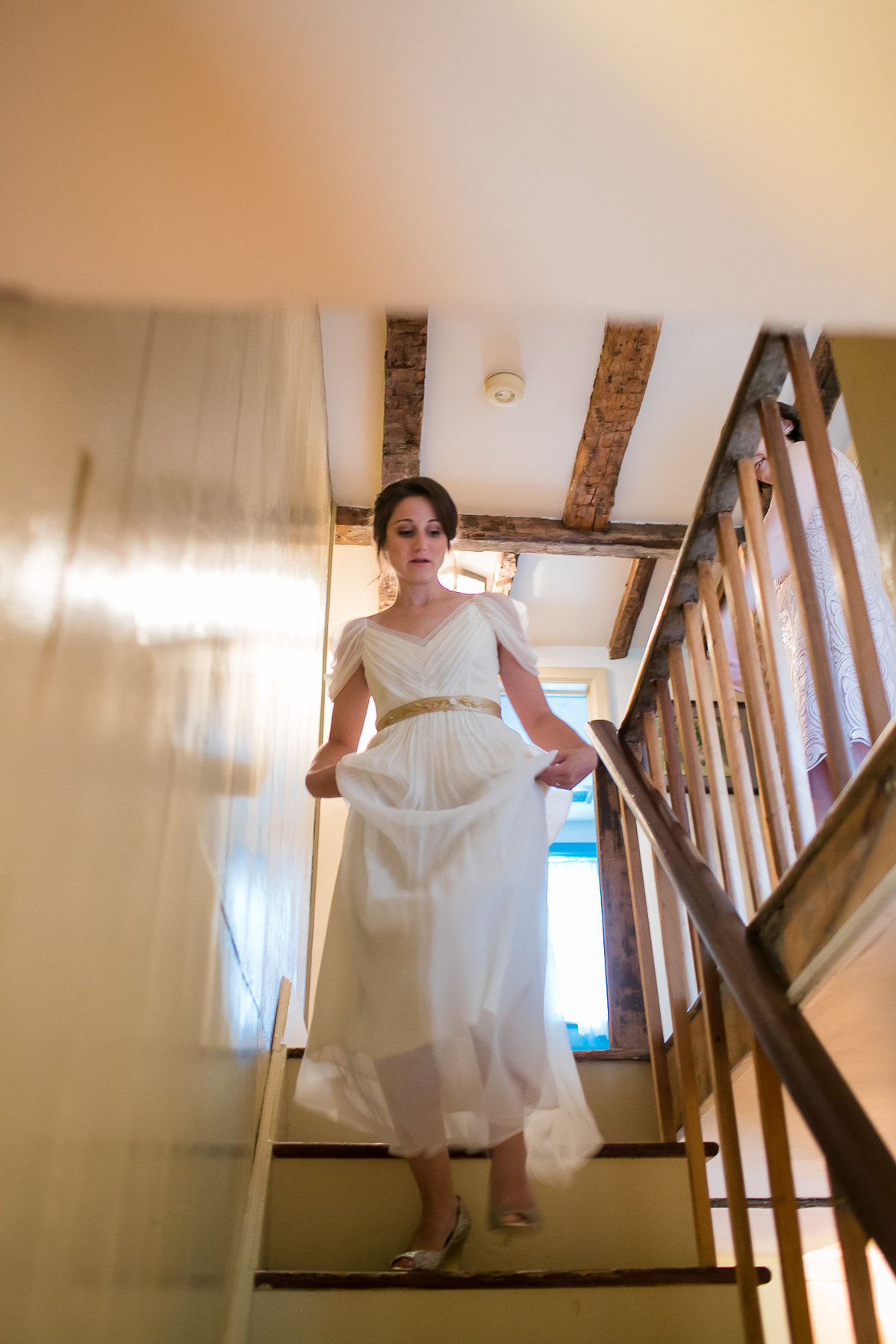 Brooklyn Wedding Photographer | Rob Allen Photography | Destination Wedding Photographer at Mt. Sinai New York  bride alking down the stairs after getting ready
