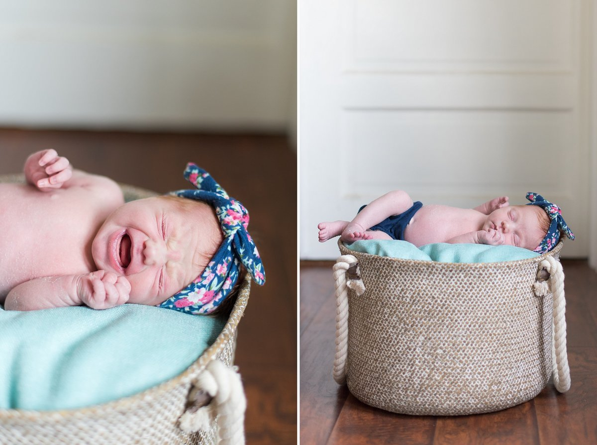 Newborn baby girl sleeping in a basket on wood floor in navy diaper cover in Washington, Pennsylvania Photo
