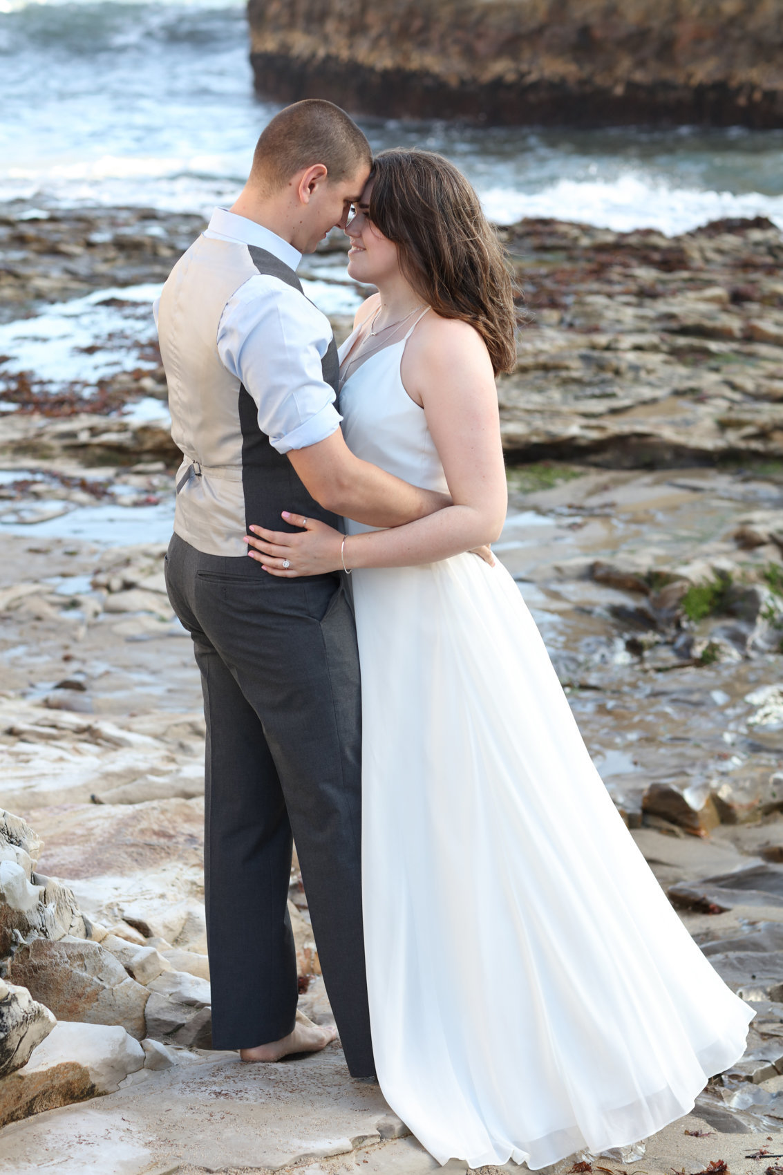 Portrait of bride and groom on beach, outdoor engagement photoshoot