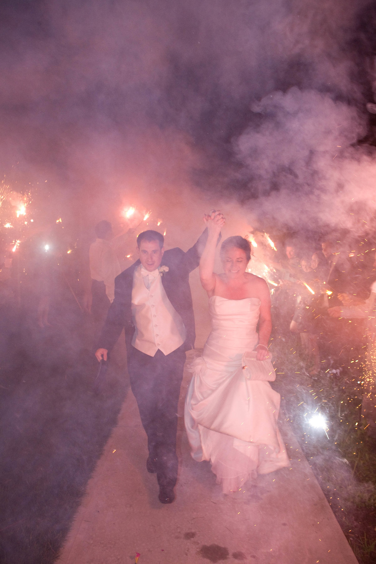 bride and groom  walking out of sparklers sendoff