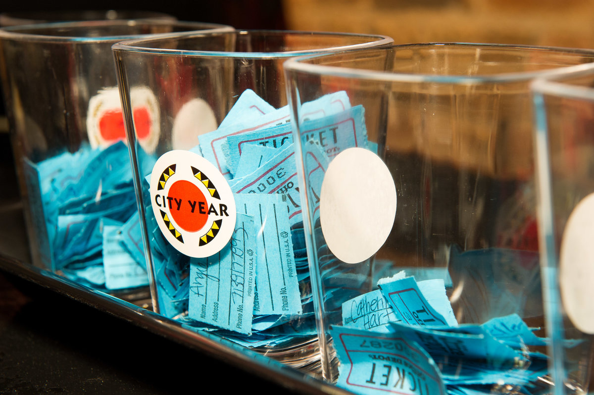 Chicago tickets rest in containers at Chicago fundraising event.