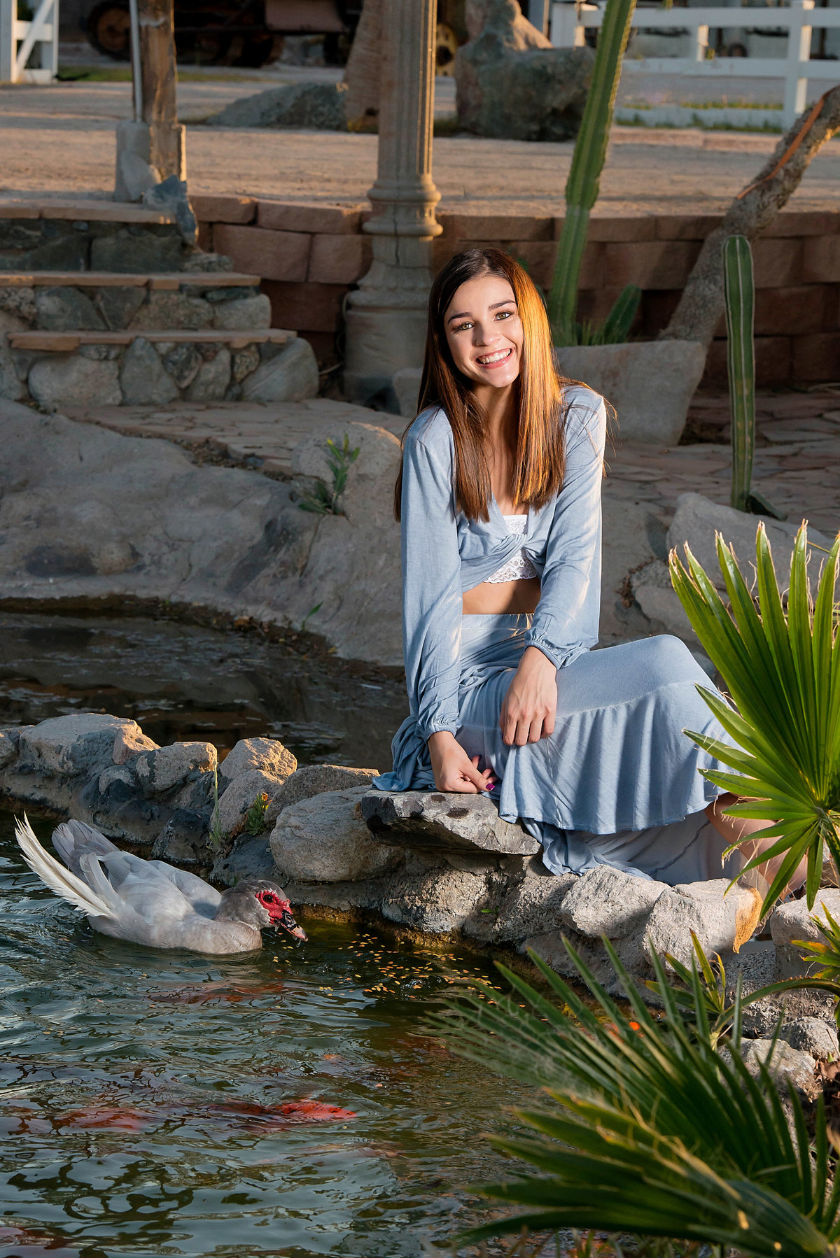 senior with pond and ducks
