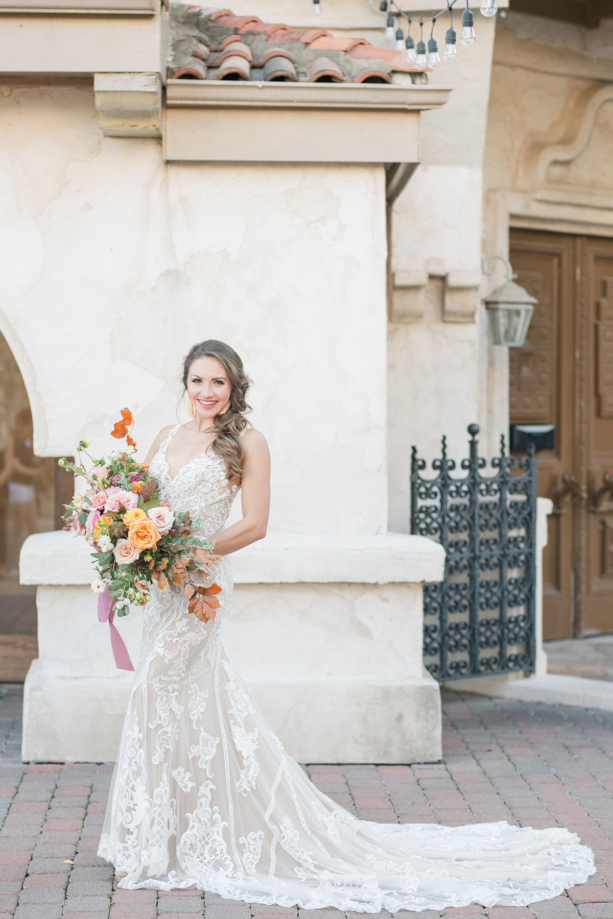 Bridal holds fall wedding bouquet at Bridal Portraits at Villa Antonia in Austin