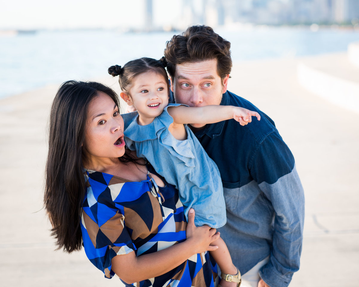 Family portrait, Chicago lakefront. Mother, father, and dauther.
