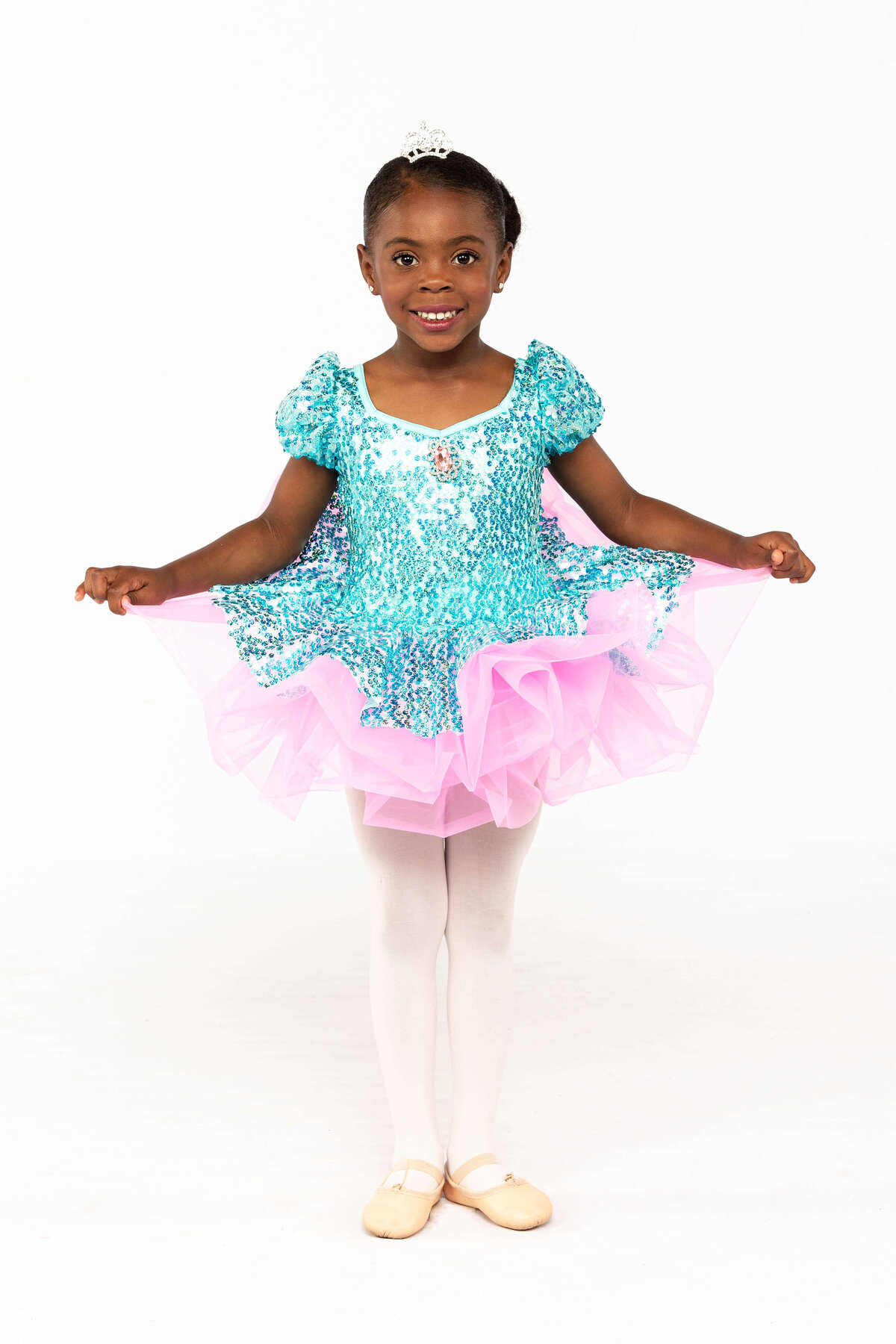 Girl dancer in blue and pink ballet tutu dress