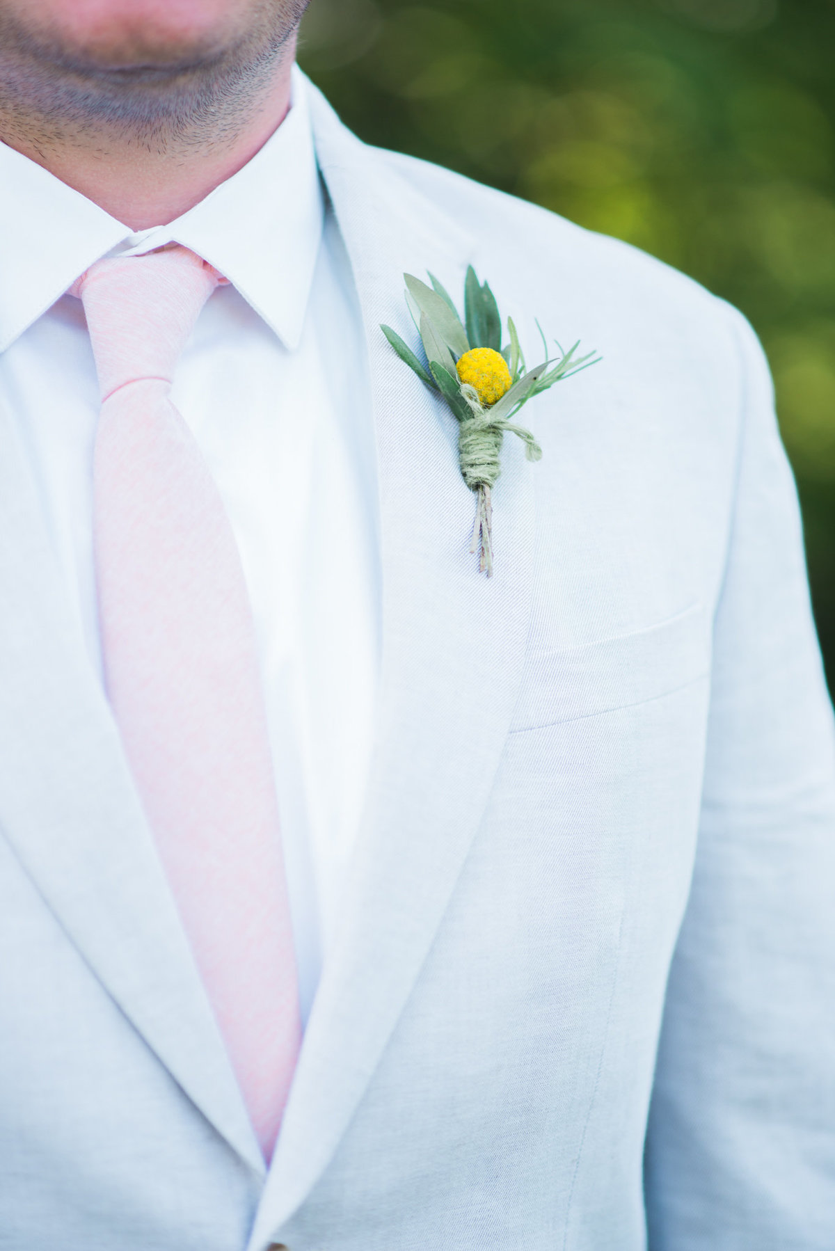 groom in gray suit, billyball boutonniere