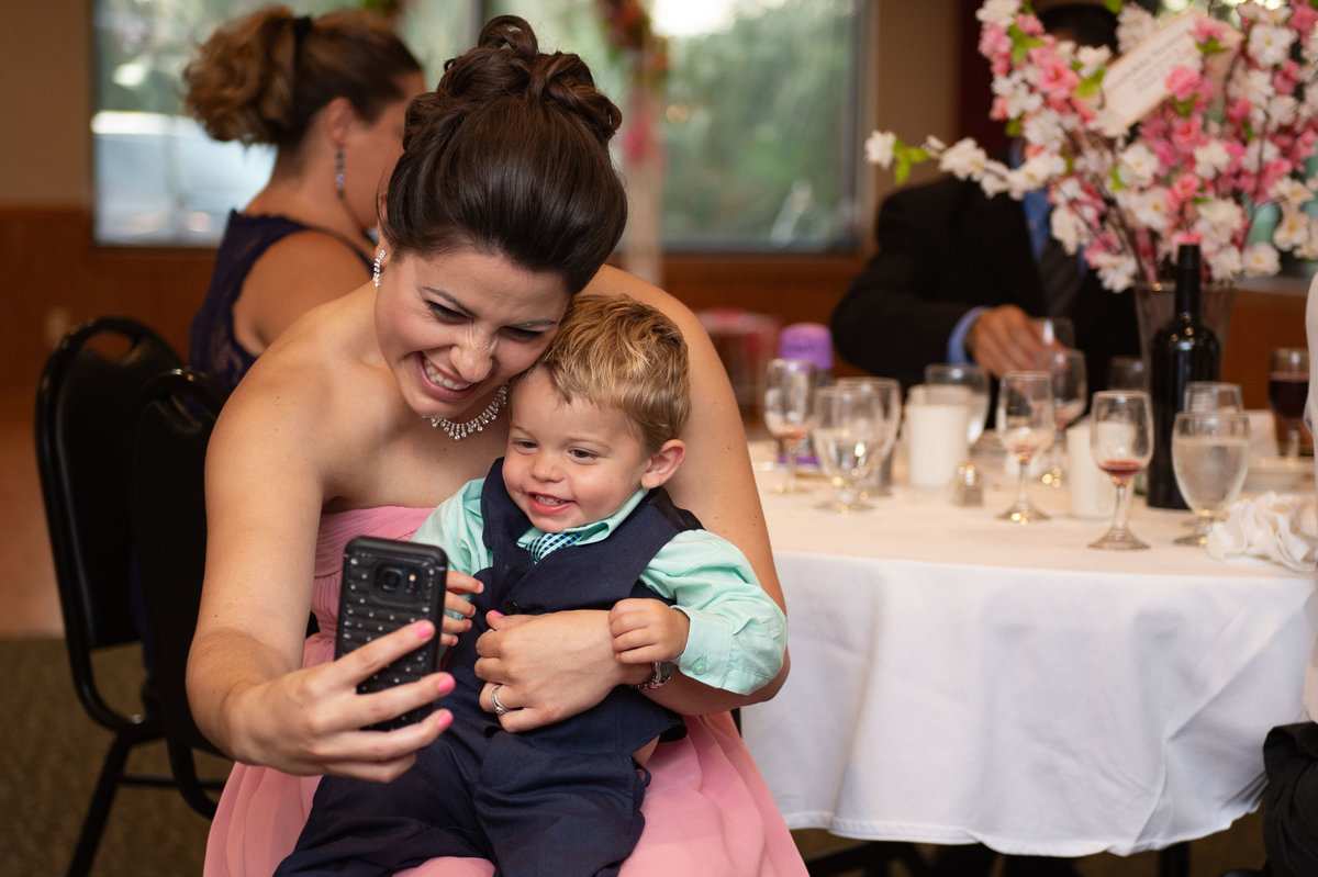 sister of bride does selfie with small boy