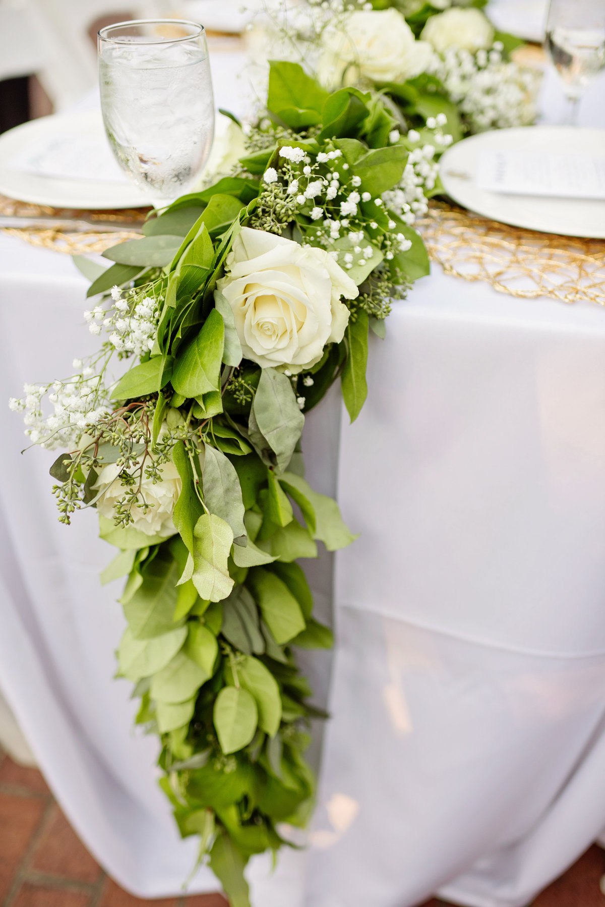 greenery table setting at wedding reception