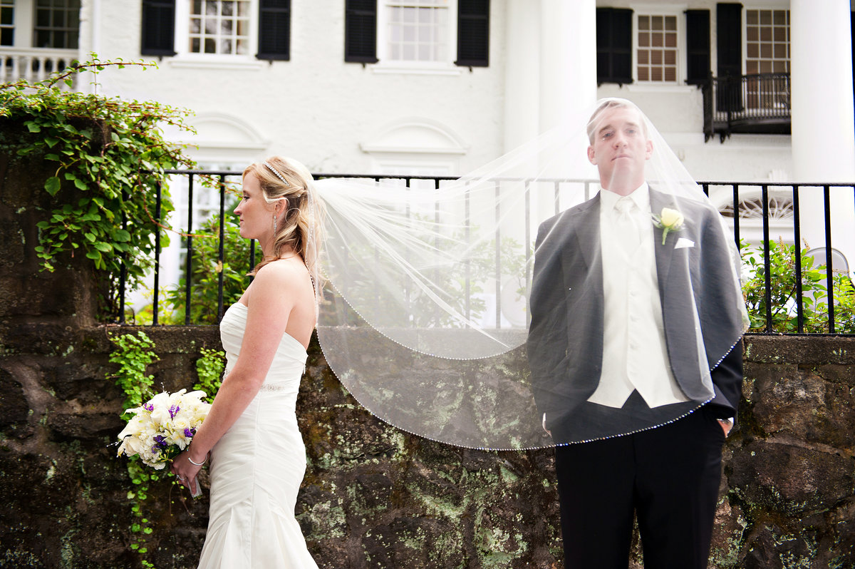 A groom gets a little weird under his bride's veil at their Radnor Valley Country Club Wedding.