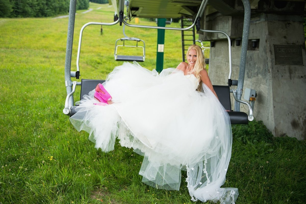 bride in the ski lift at Jay Peak Resort during her outdoor summer wedding