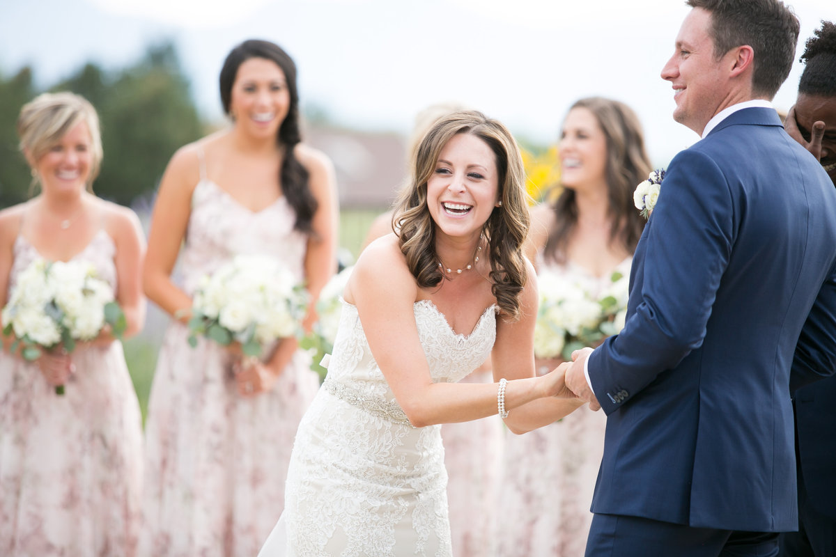 Bride laughing during wedding ceremony captured by Melissa Sue Photography