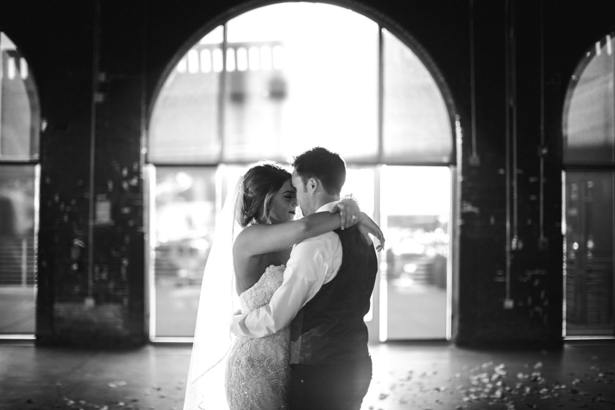 Bride and groom first dance in black and white at Jackson Terminal Wedding Venue by Knoxville Wedding Photographer, Amanda May Photos.