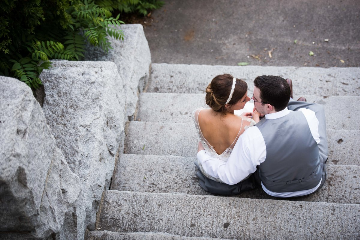 Bride and groom on stone stairs, Chicago, shot from above.