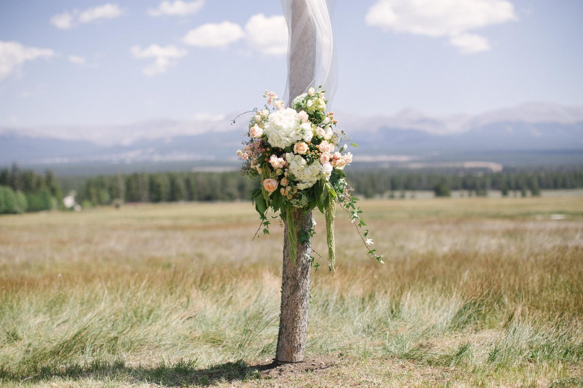 wedding arch floral mountain