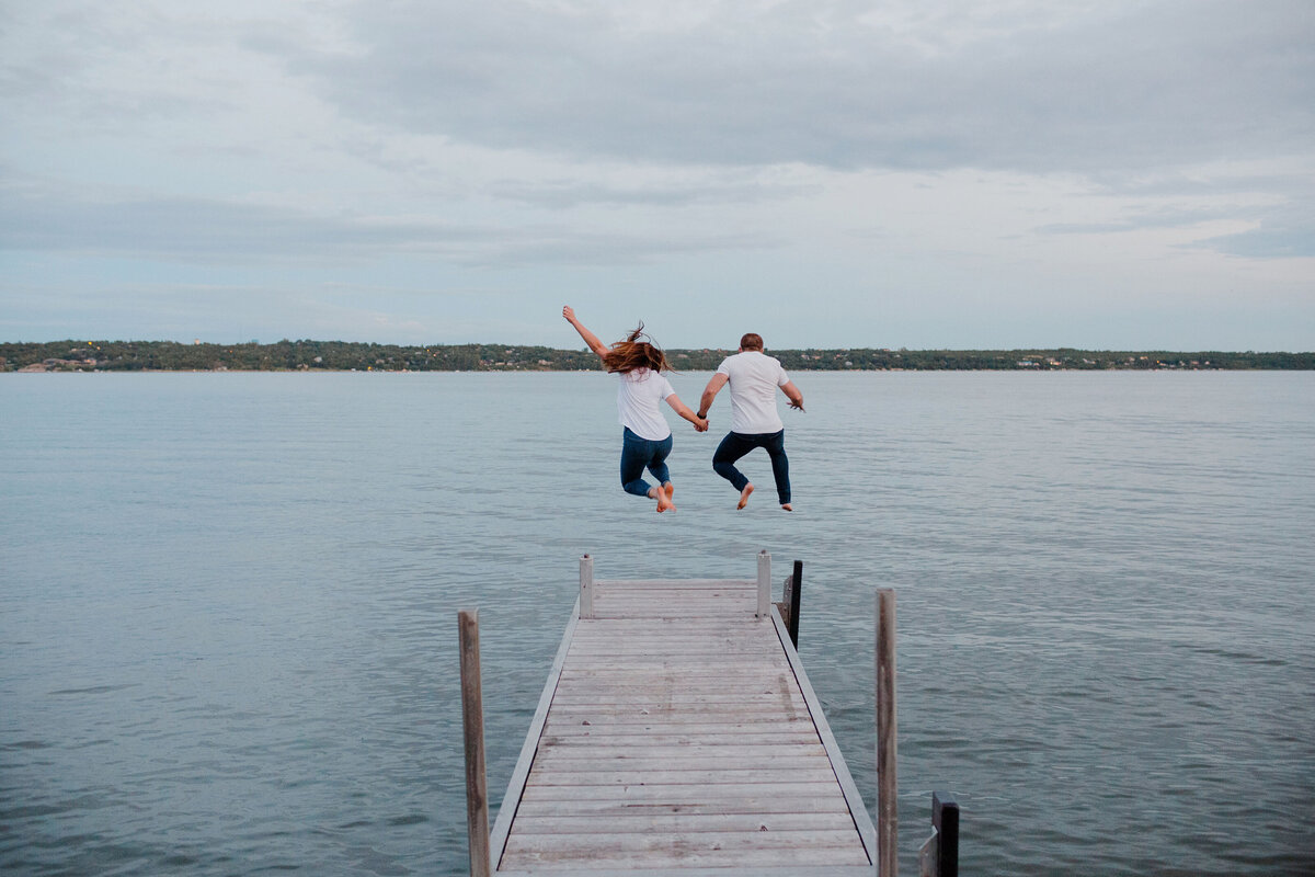 Couple jumps into the lake with their clothes on