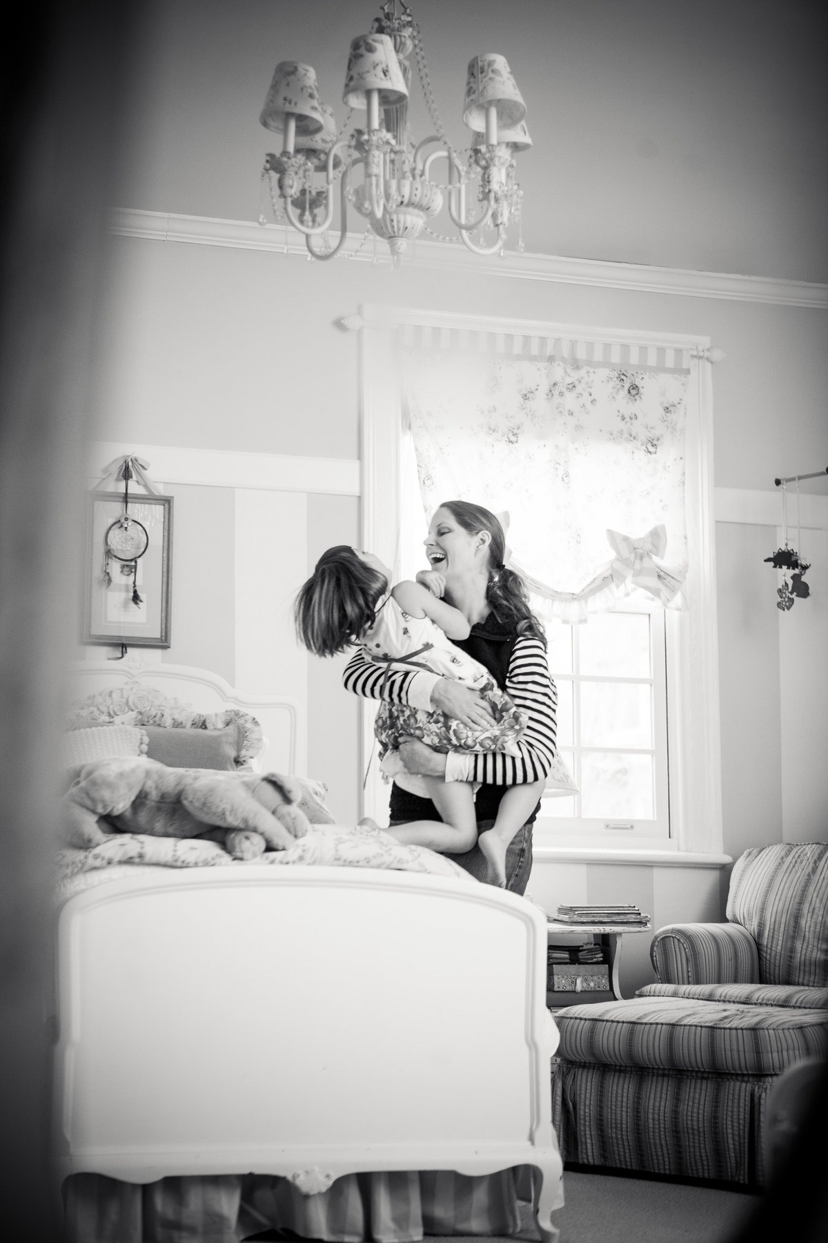 In home candid  lifestyle photography of mother and daughter child in Newburgh by Hudson Valley NY professional family photographer