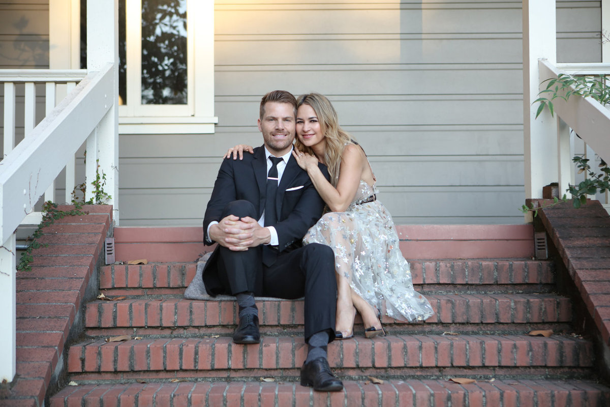 Engagement Photos on a Porch with Brick Steps at Holbrook Palmer Park