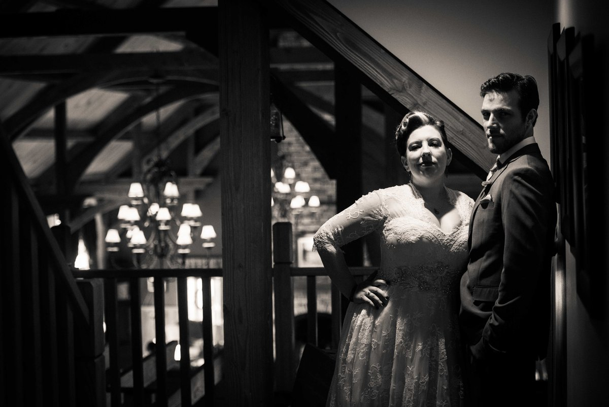 Bride and groom pose in shadows, Hocking Hills Ohio wedding.