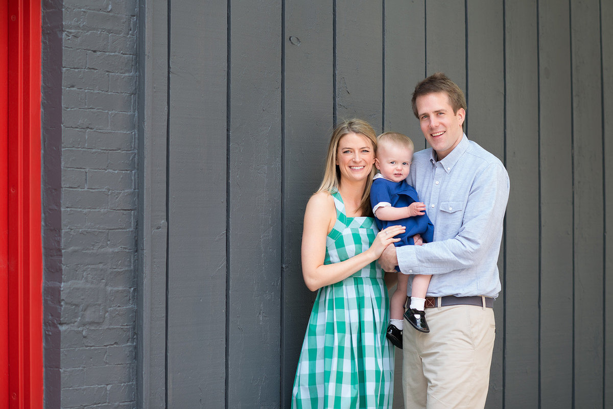 a family poses in the west loop on the sidewalk
