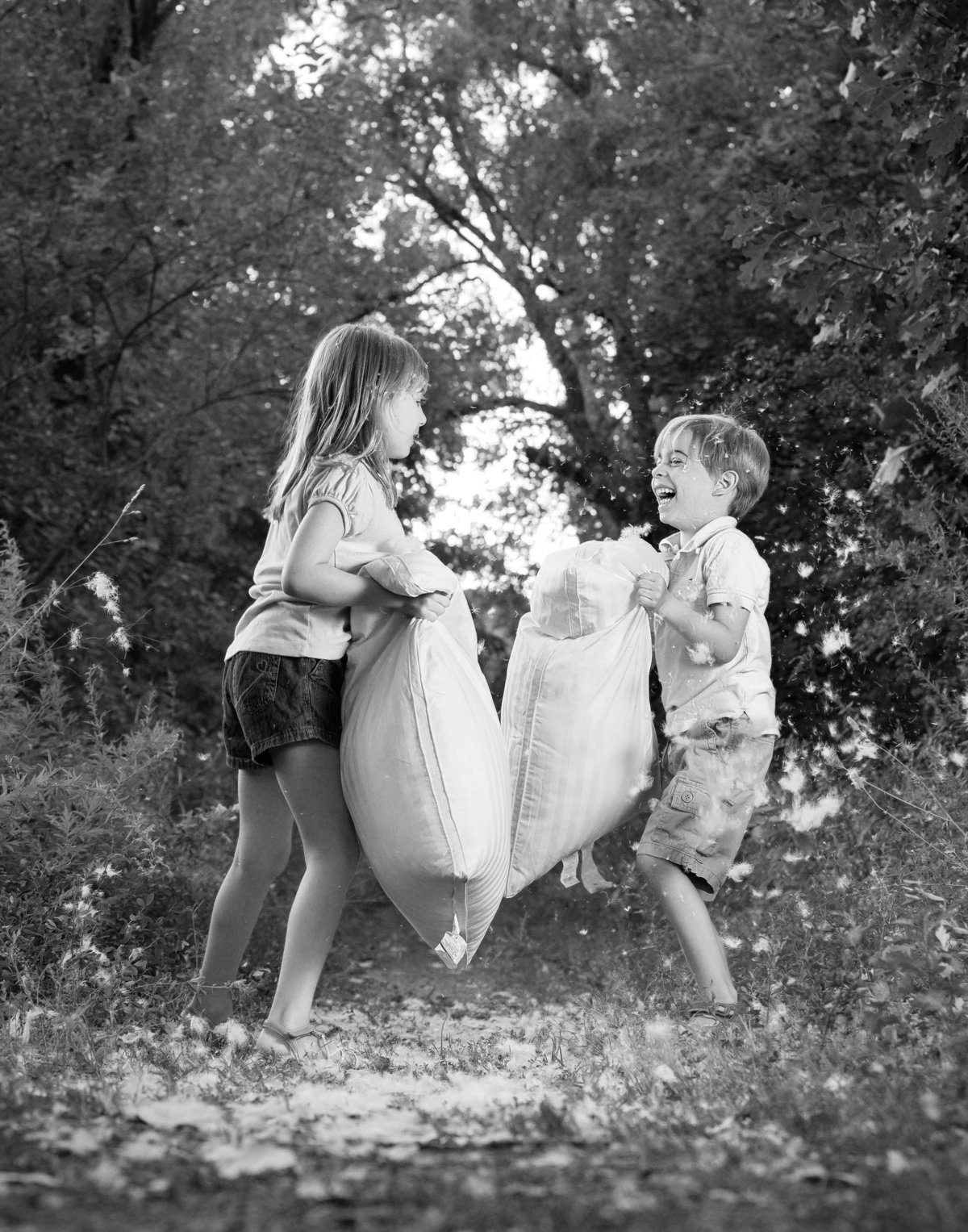 fun pillow fight between kids by Hudson Valley child photographer in New Windsor NY