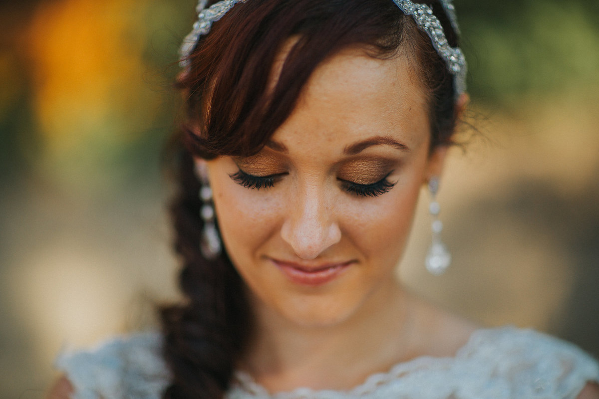 Close up photograph of brides make up and earrings