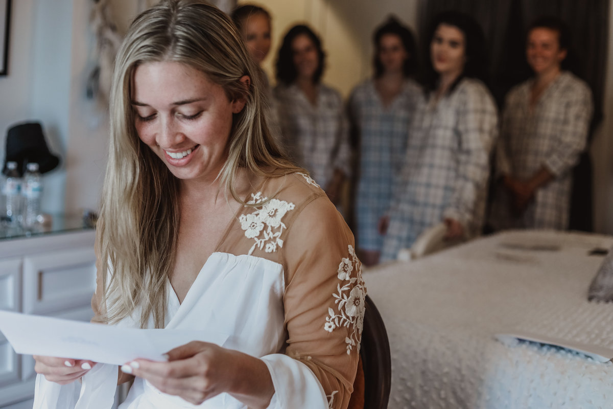 bride reading wedding letter