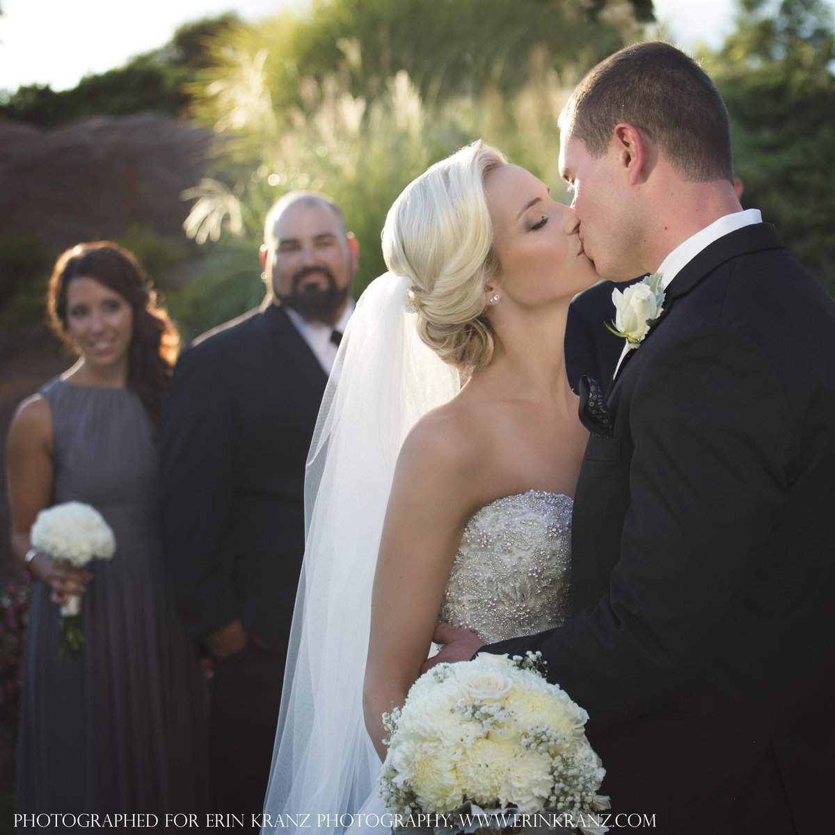 charlotte wedding photographer jamie lucido captures an image of the bride and groom kissing at an outdoor wedding Pine Island Country Club