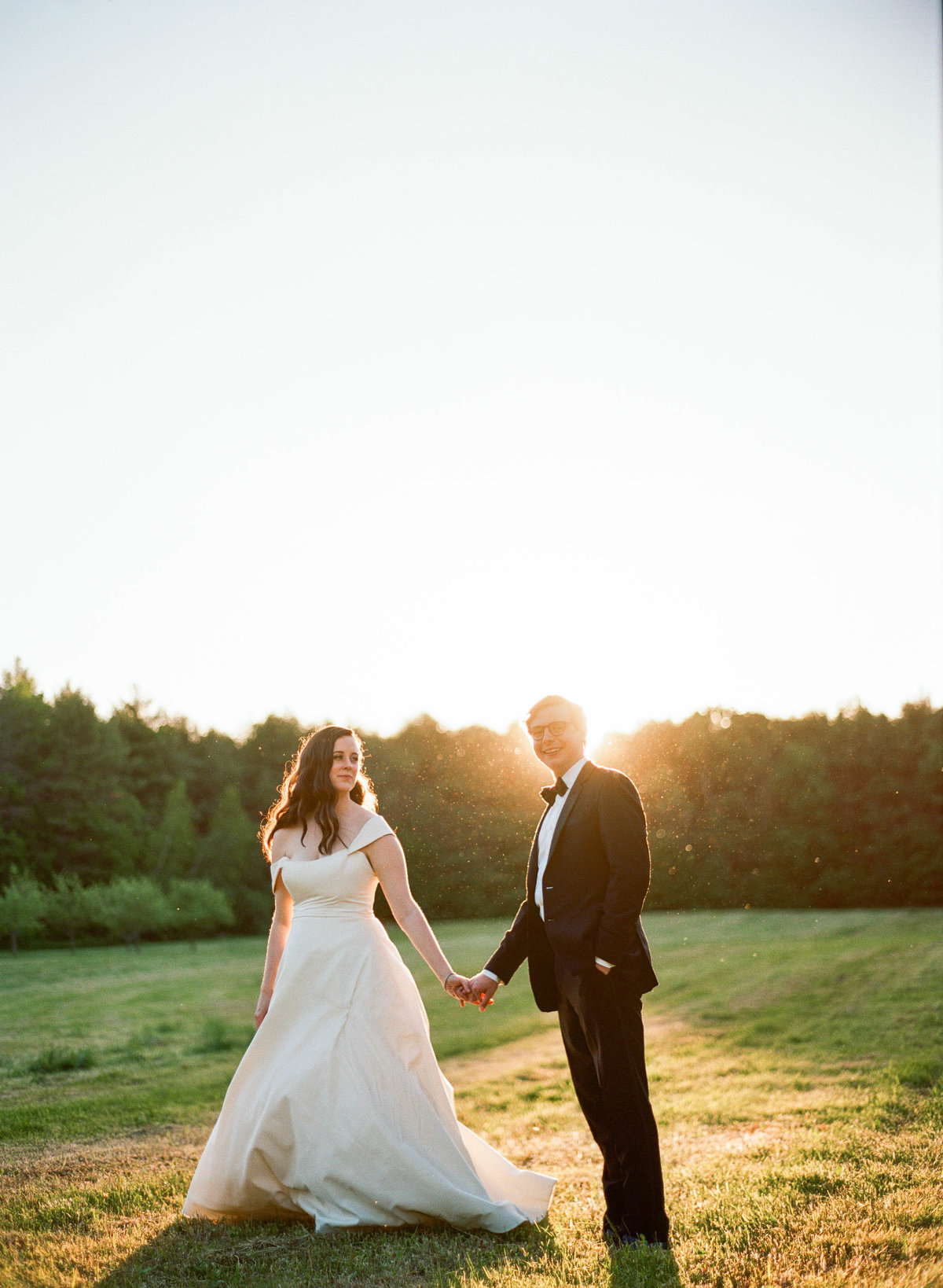 maine wedding couple in field at sunset the barn at flanagan farm