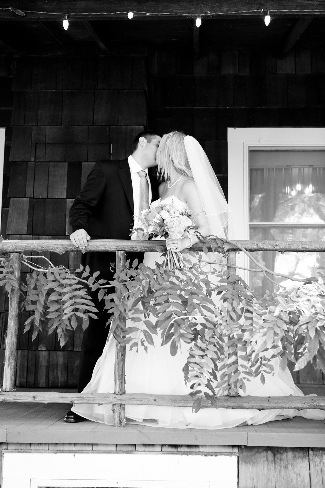 Wedding photography black and white woodsy setting greenery and rustic elements