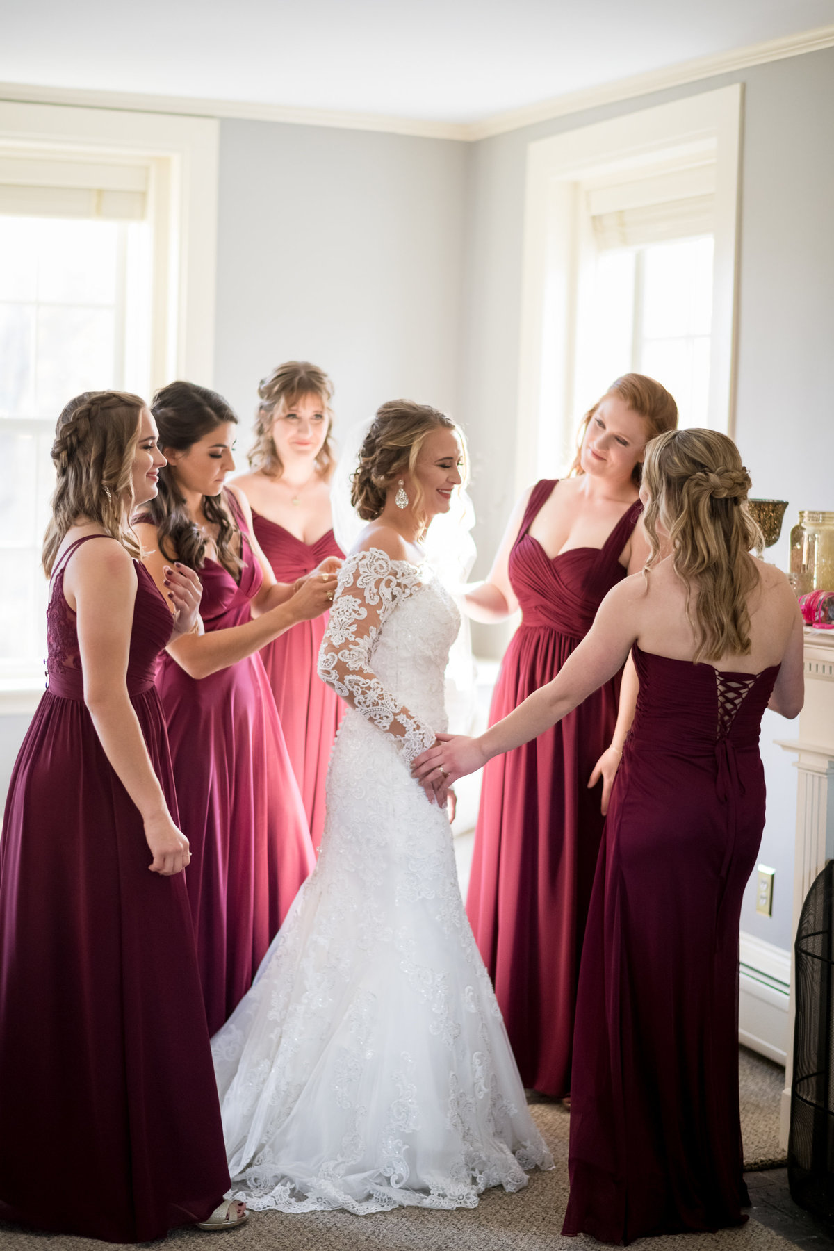 bride and bridesmaids in burgundy dress