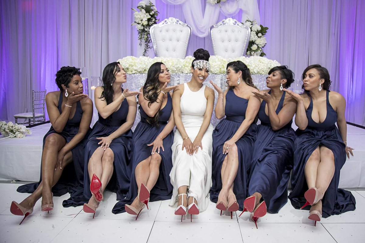 bride and bridemaids with red bottoms