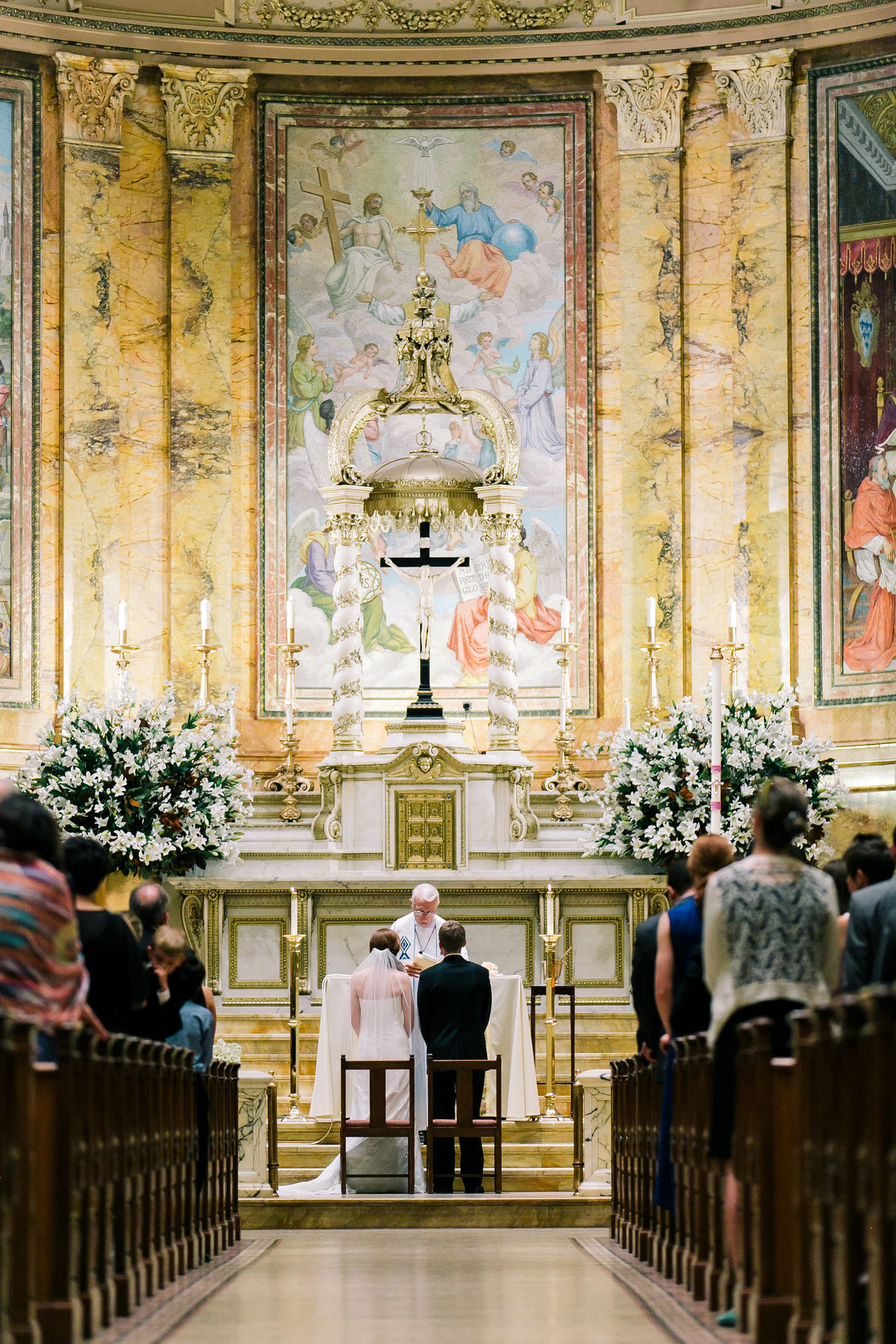Bride and groom getting married at St. Ignacious Loyola Church NYC