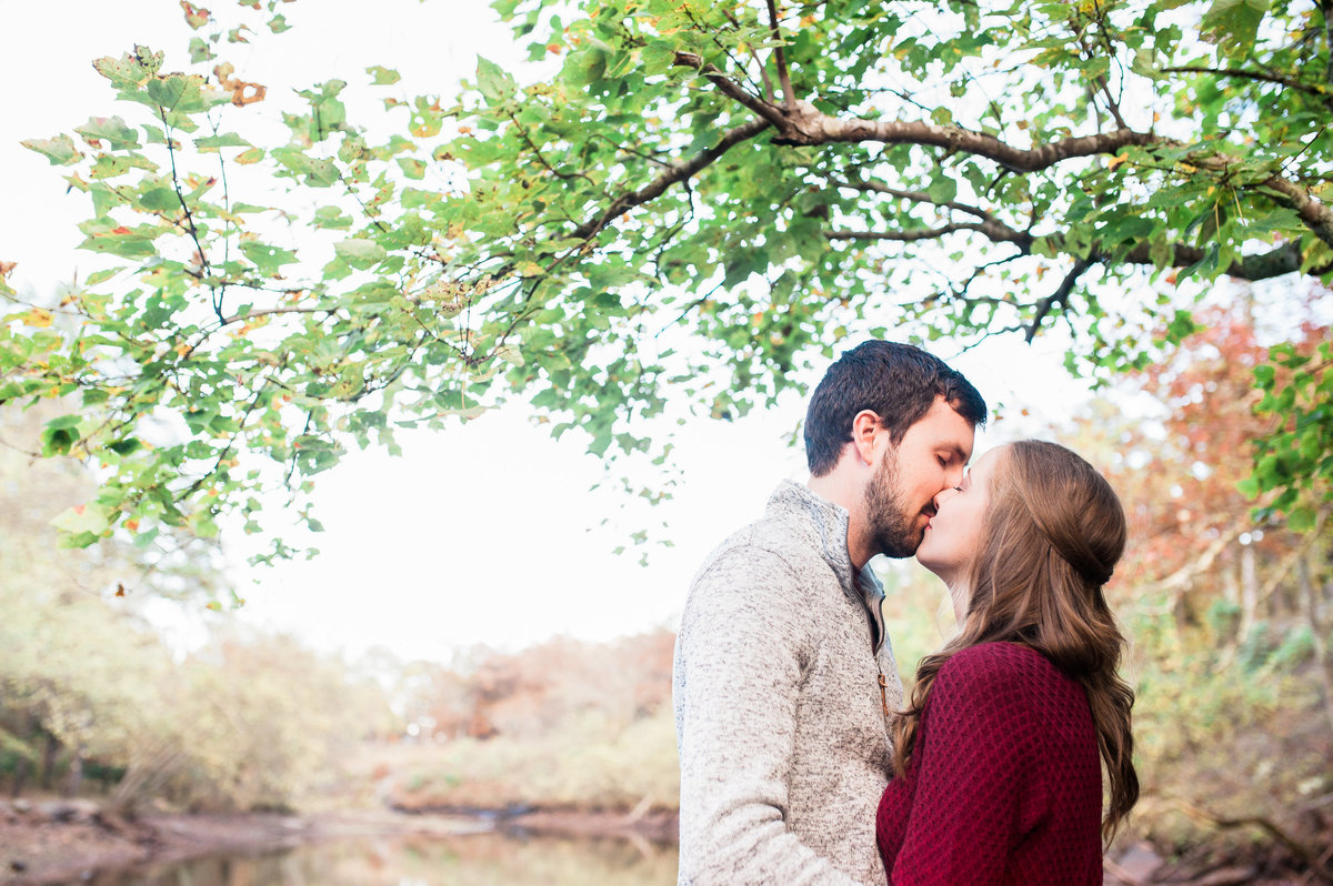 Bentonville and Fayetteville Engagement and wedding photographer, NWA wedding and engagement photographer, engaged couple in love kissing, engagement photo inspiration-17