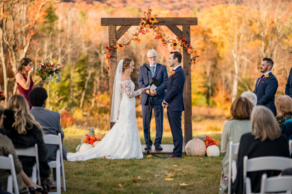 wedding ring exchange during ceremony outdoor in NH