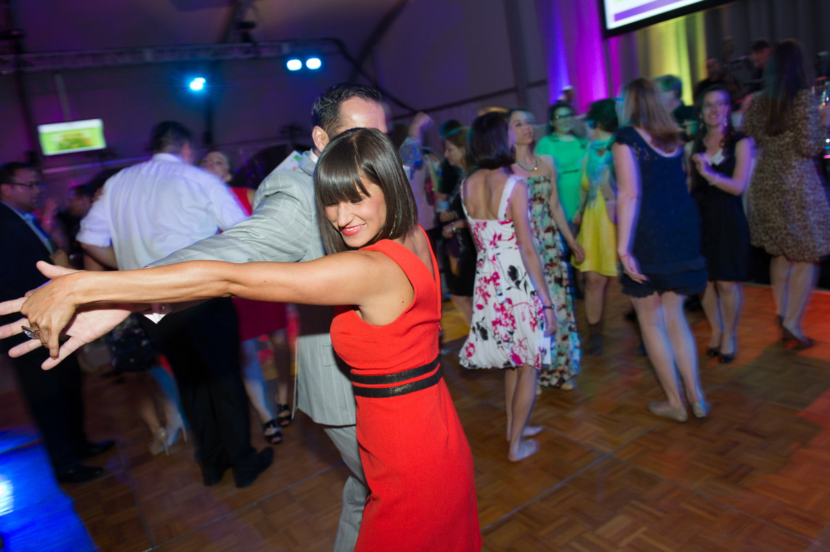 Attendees dance on dance floor at Chicago fundraiser.