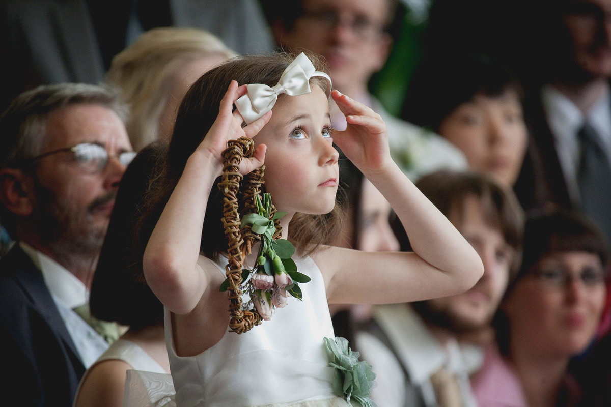 cute flower girl reportage wedding photographer