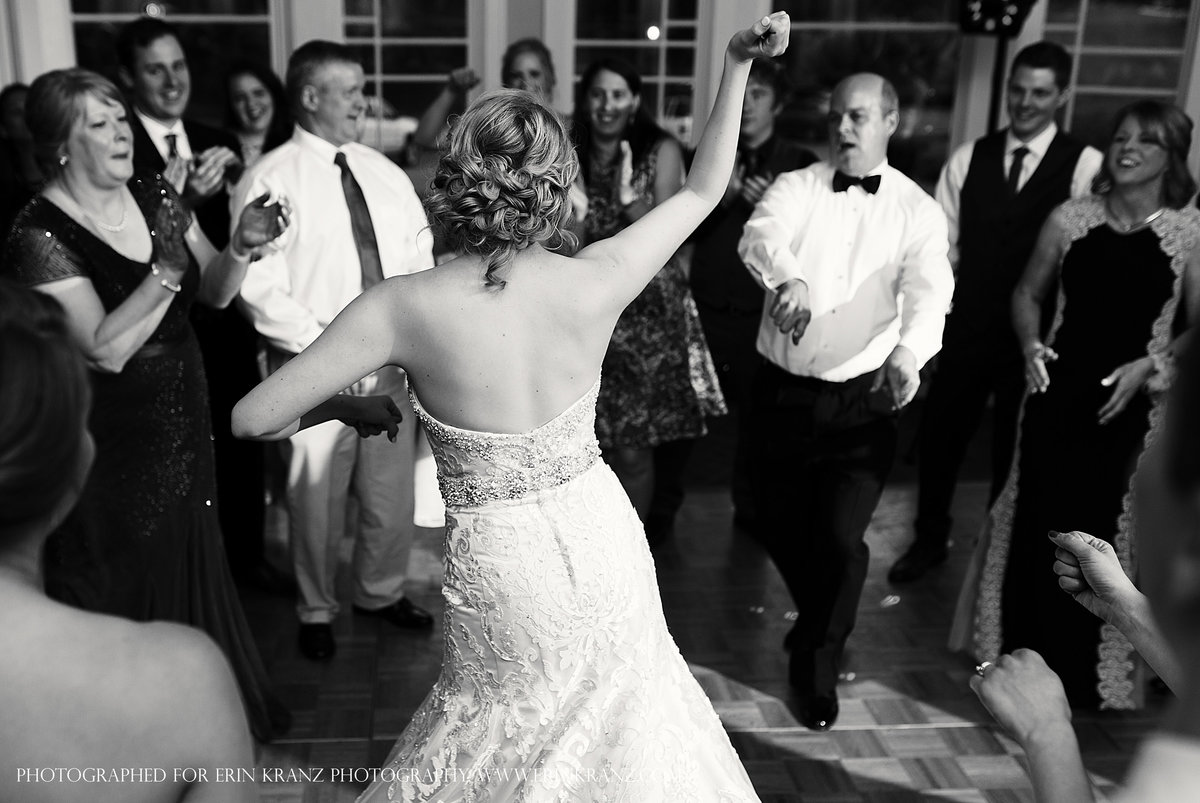 charlotte wedding photographer jamie lucido captures the documentary detail at a reception with the bride dancing with her father and the guests cheering on