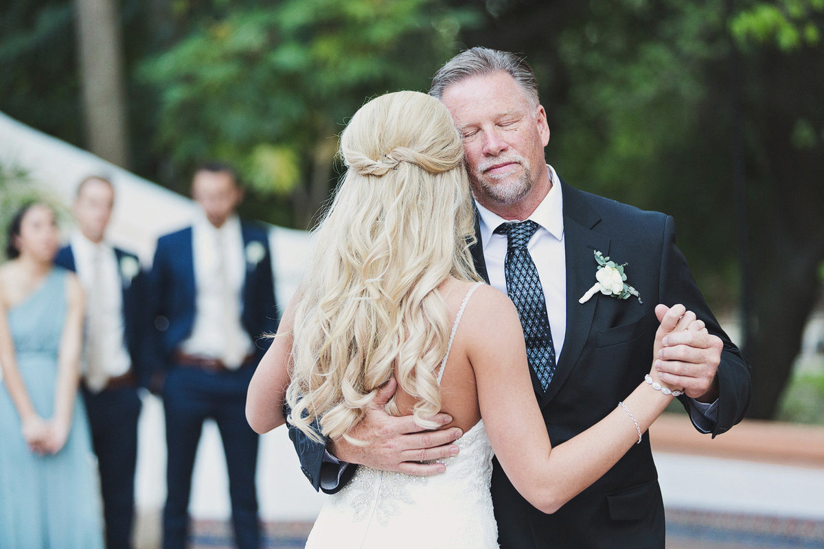 a bride dances with her father