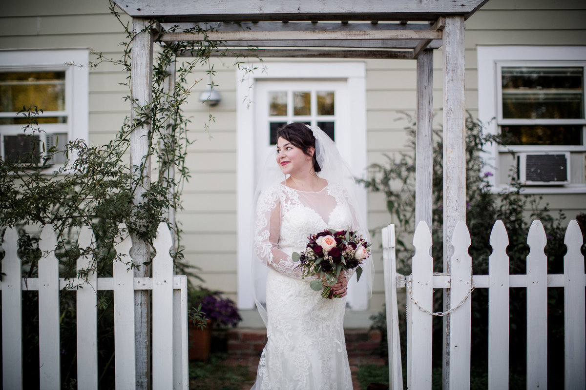 Bridal portraits under a white arbor at the barn at highpoint farms by Knoxville Wedding Photographer, Amanda May Photos.