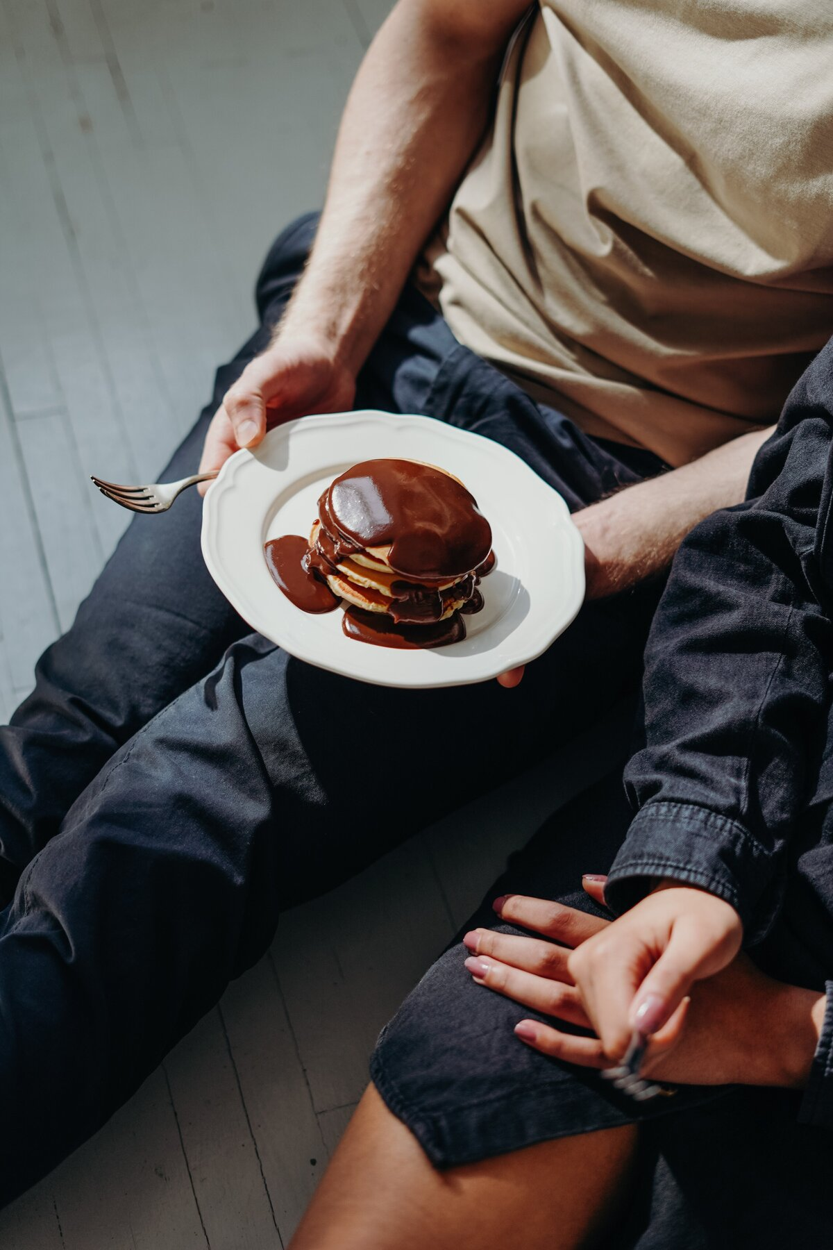 person-holding-plate-with-chocolate-pancakes-3692871