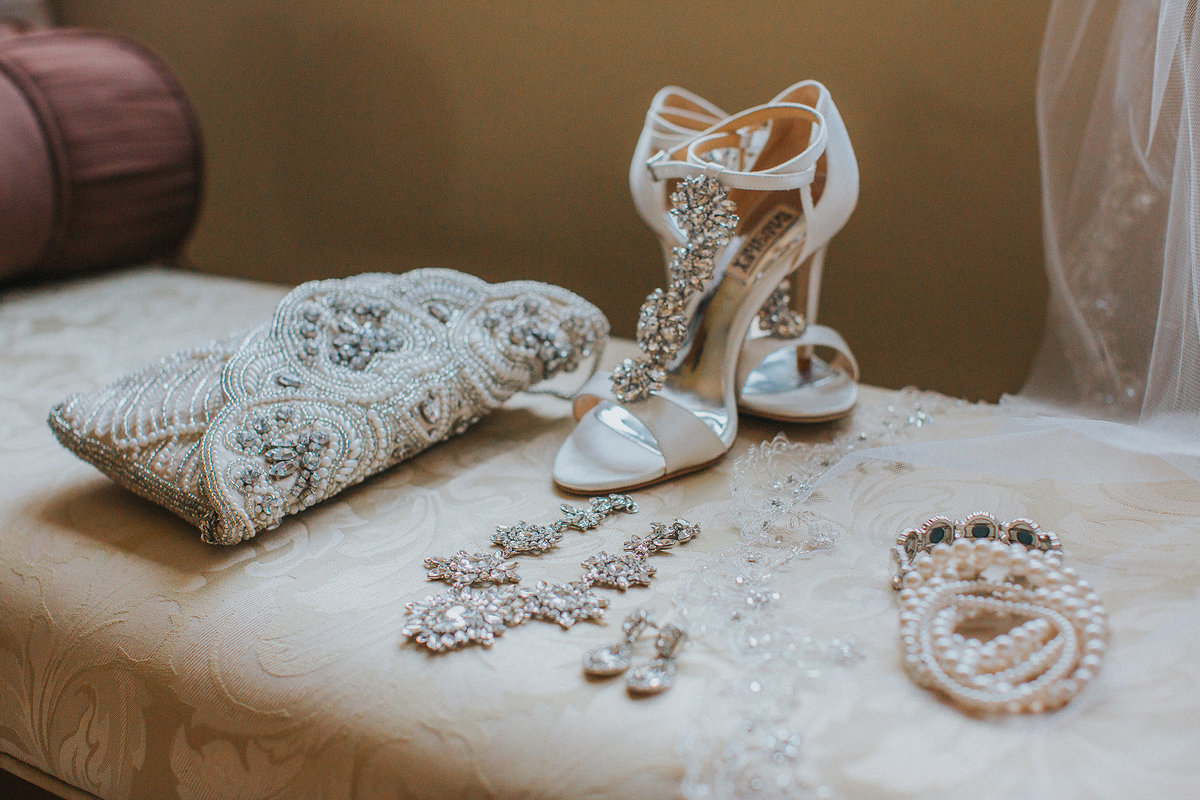 all of brides details including shoes purse earring and necklace