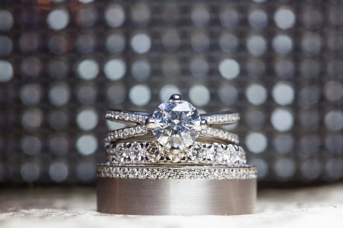 bride and groom's wedding rings and wedding bands