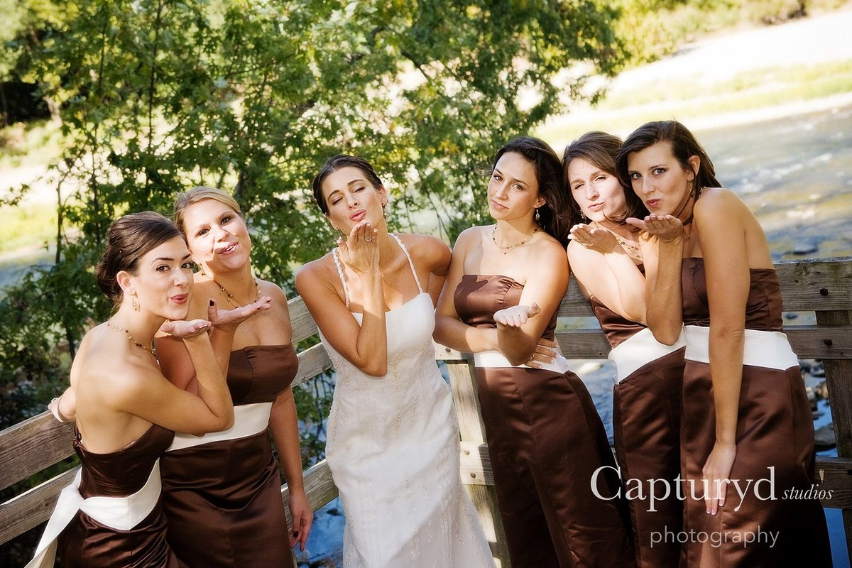 Bridesmaids blowing kisses