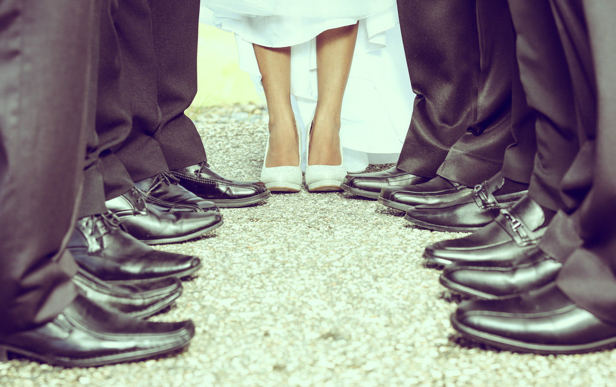 Feet of bride and groomsmen. Photo by Ross Photography, Trinidad, W.I..