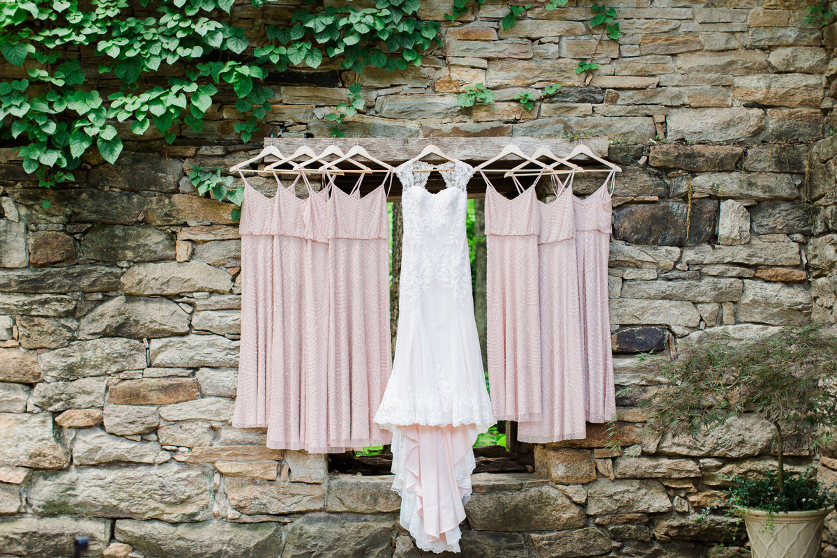 Hanging gowns on stone wall
